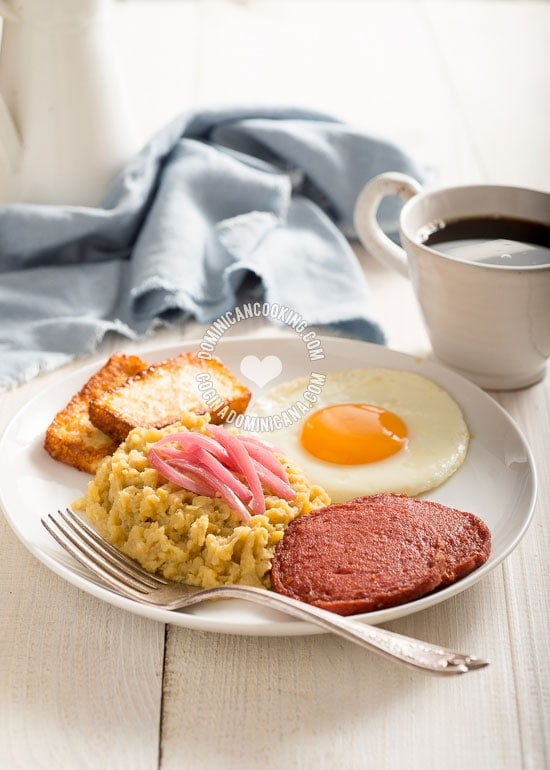 Traditional Dominican breakfast of mangu, salami, eggs and fried cheese.