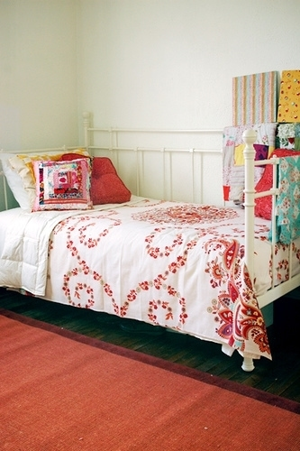 Anna's guest bedroom shares the space with her studio. I love the cheery, colorful fabrics on the daybed.