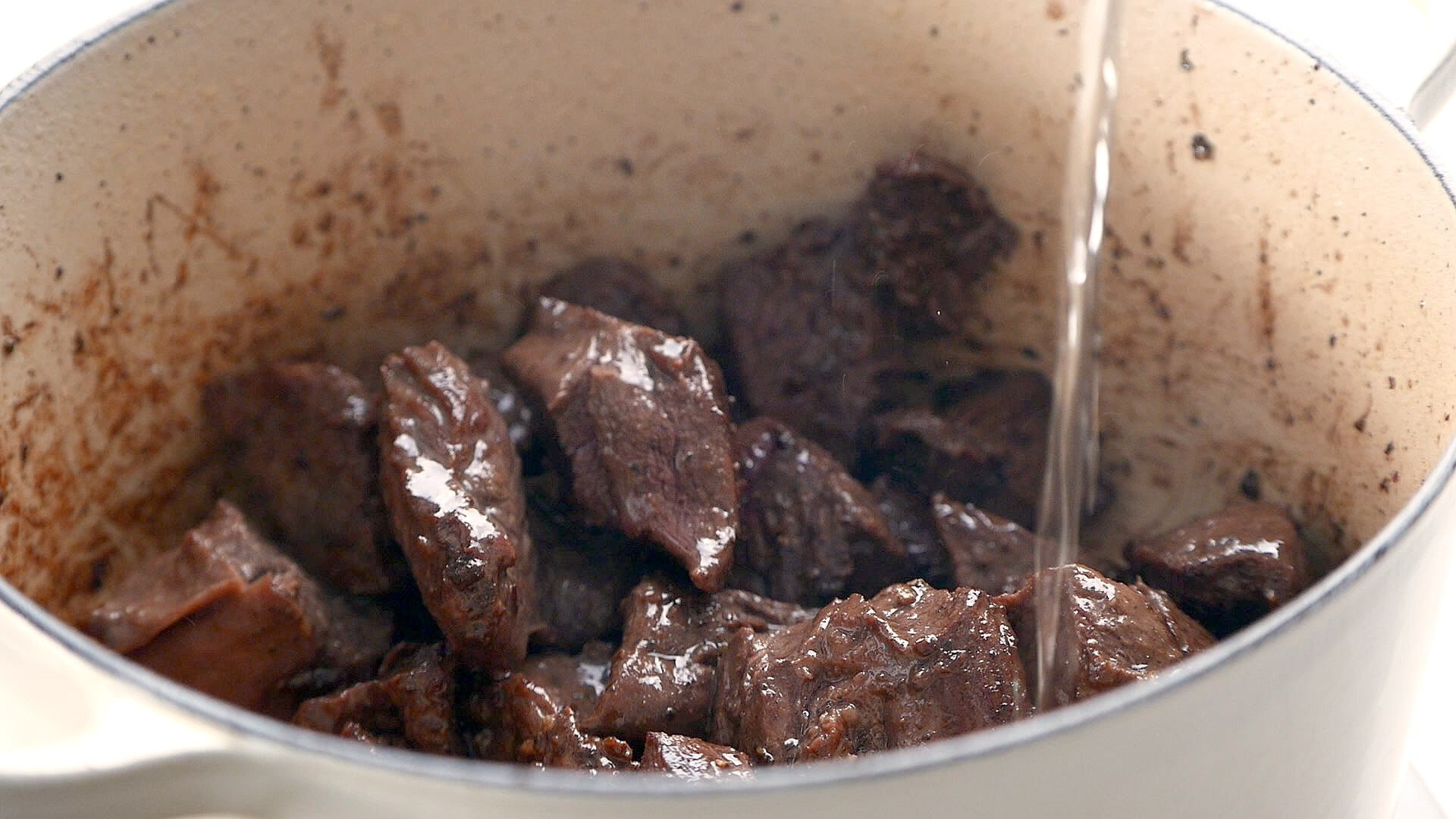 Adding water to browned meat
