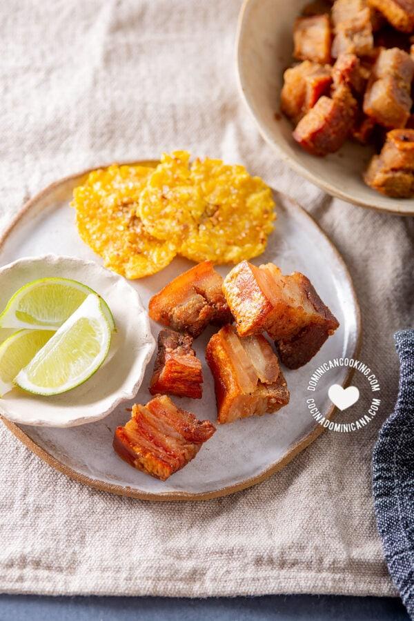 Air fryer chicharrones with tostones and lemon wedges