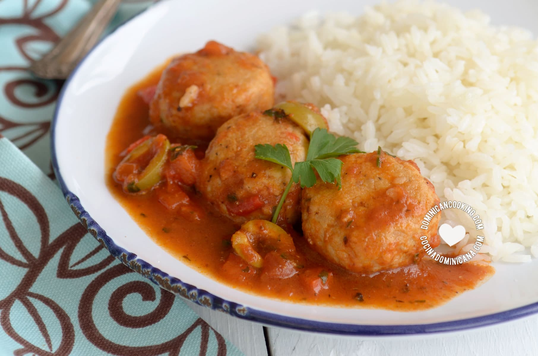 Fishballs in tomato sauce served with white rice
