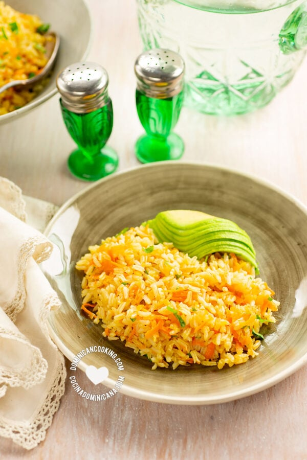 Arroz Amarillo Served with Avocado (Carrot and Onions Yellow Rice)