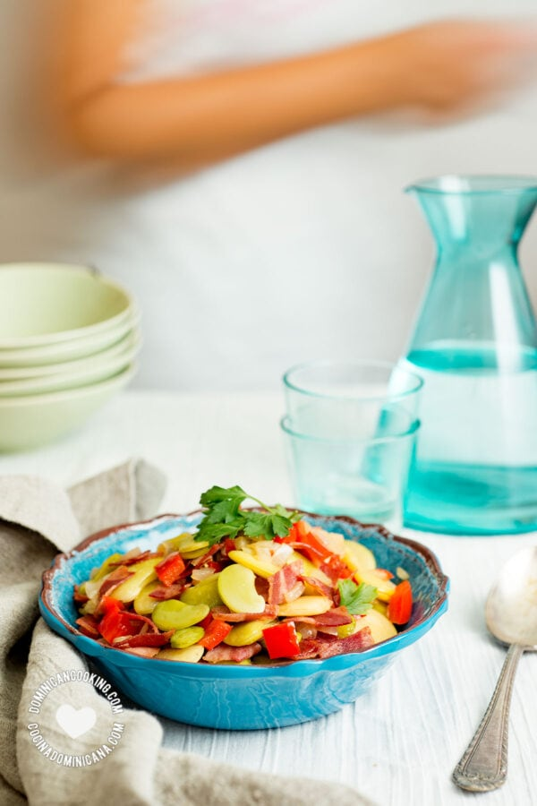 Fava bean and bacon salad, person passing behind table