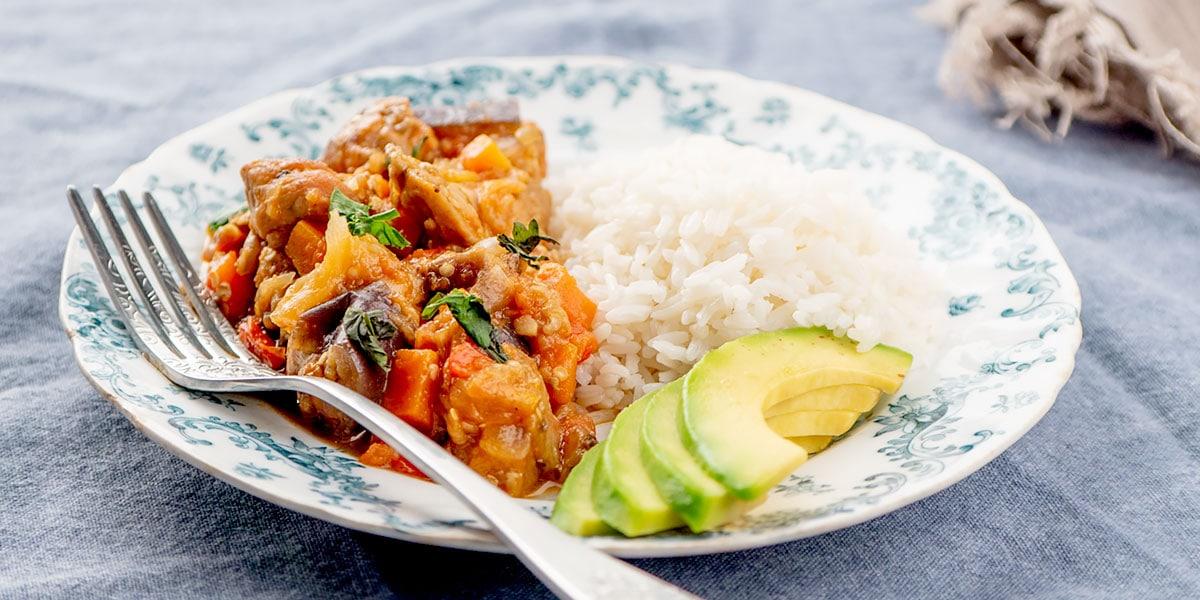 Eggplant dish with rice and avocado