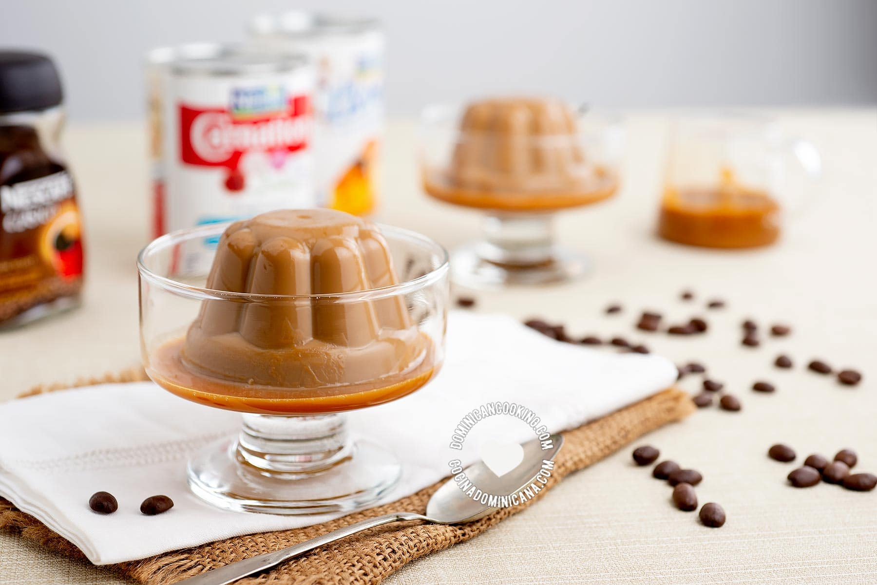 Table with Pouring sauce over Café con Dulce de Leche Pudding and Ingredients