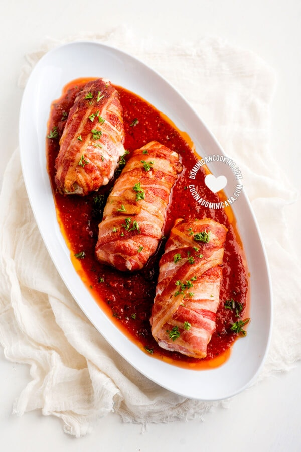 Tray with 3 Bacon-Wrapped Chicken Rolls on Tomato Sauce