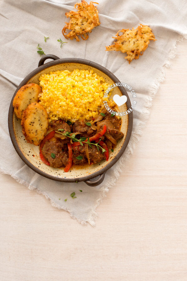 Goat with cracked corn pilaf