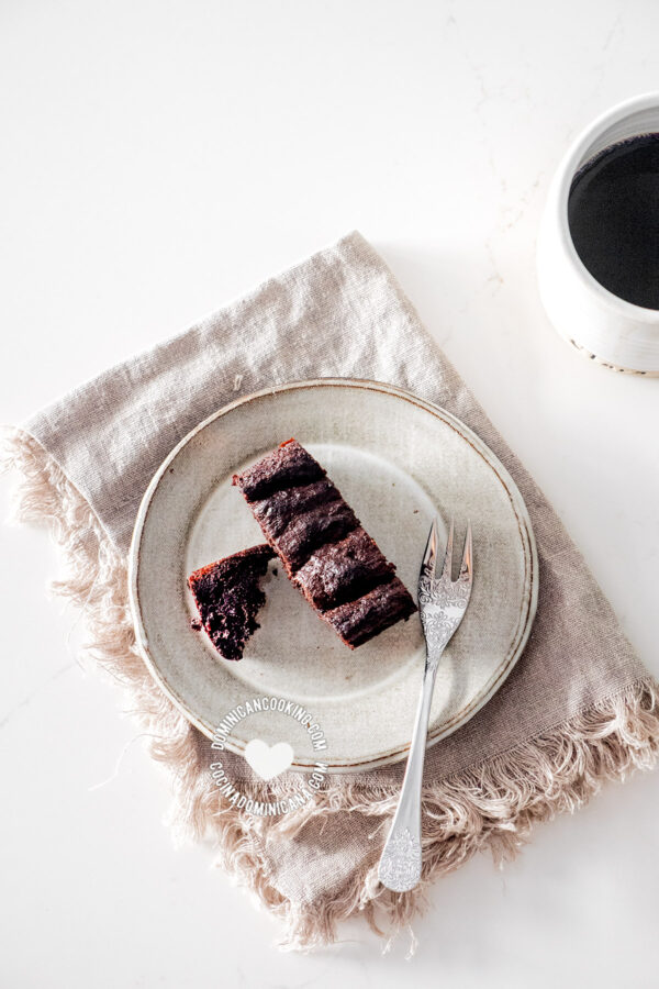 Slice of chocolate cake and a cup of coffee from above