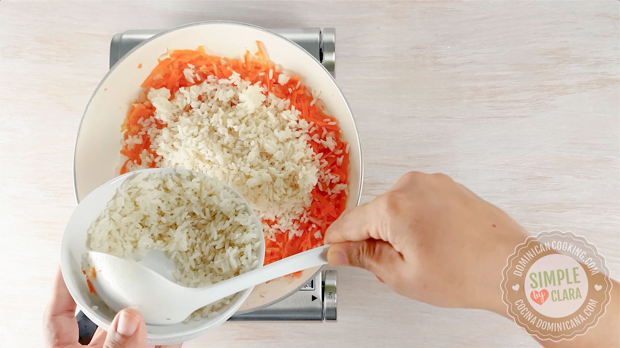 Adding rice to skillet with carrot