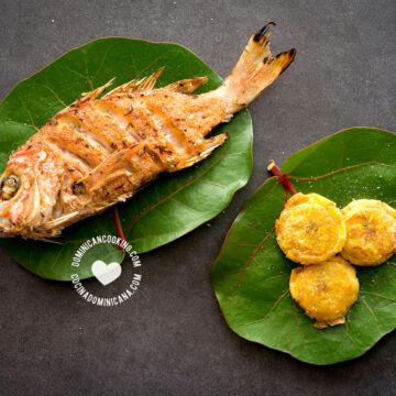 Fried fish (pescado frito) on leaves with fried plantains
