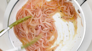Stirring onions with vinegar