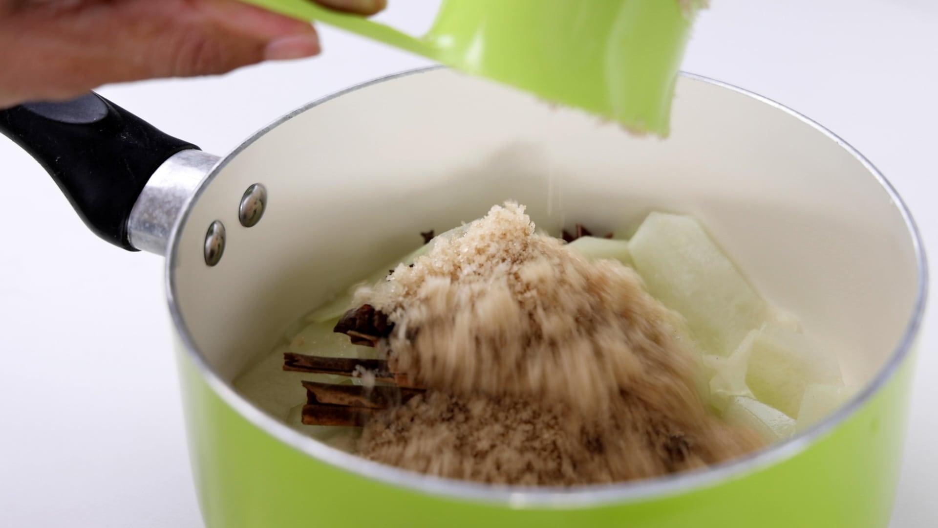 Adding sugar to the saucepan