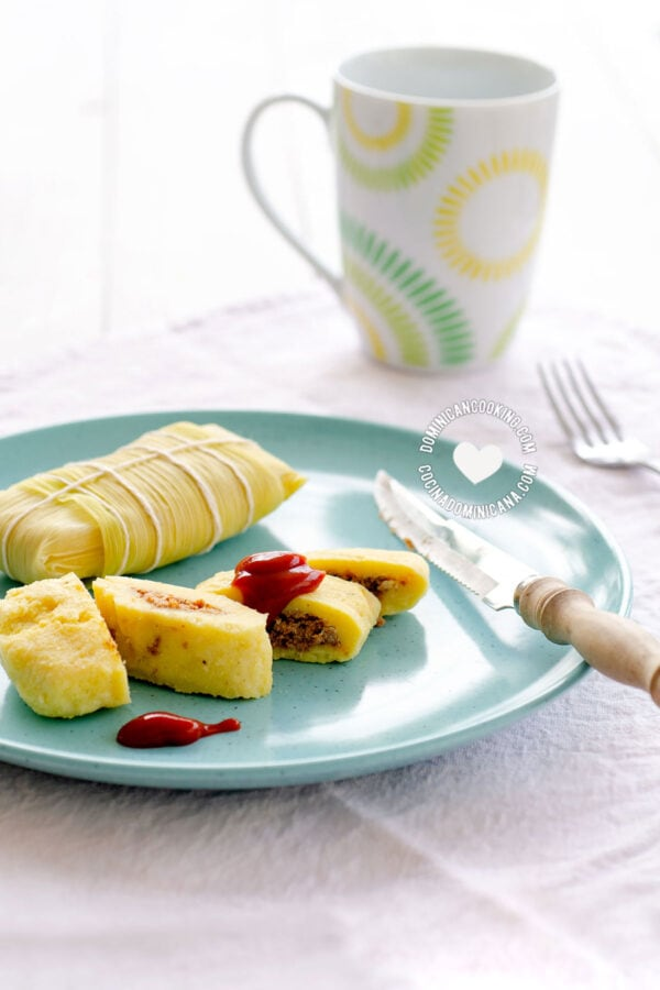 Guanimos Salados (Cornmeal and Beef Pockets) on Blue Plate