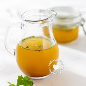 Homemade vegetable broth in pitcher and jar