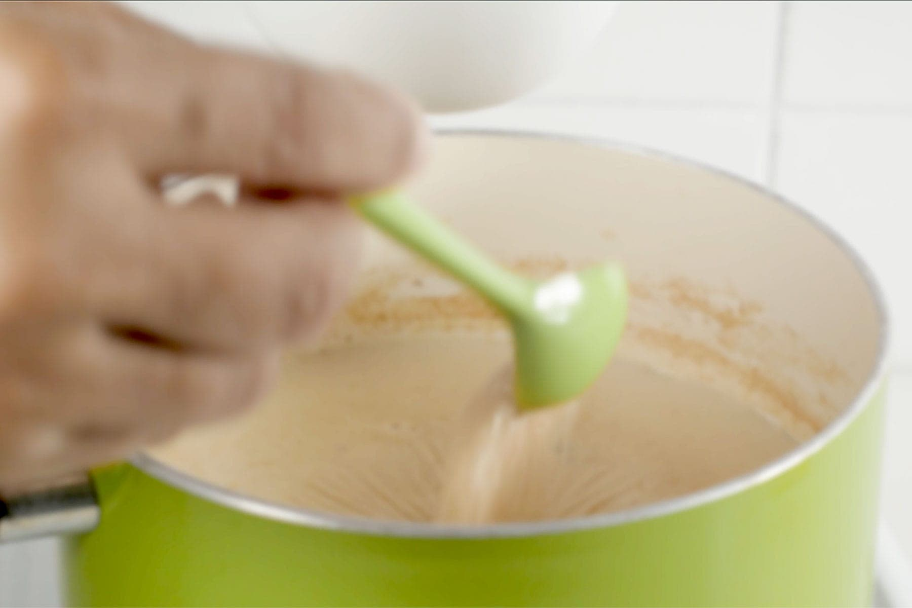 Adding sugar to mixture while it reduces