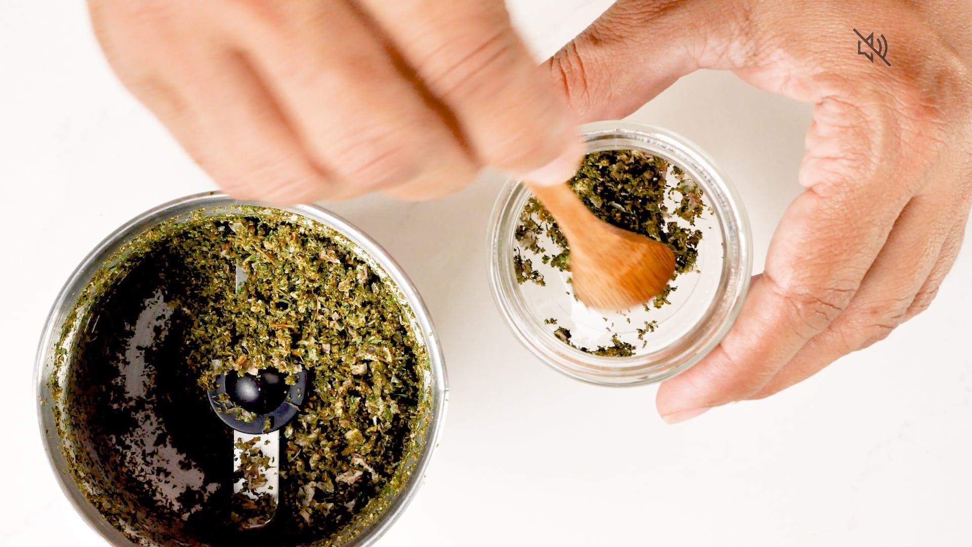 Scooping seasoning from jar