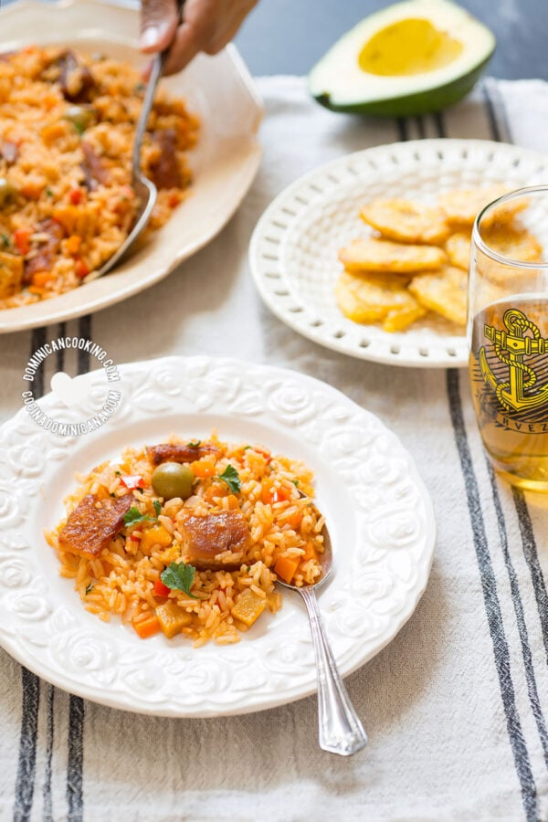 Plates with Locrio de Chicharrón de Cerdo (Rice and Pork Crackling)