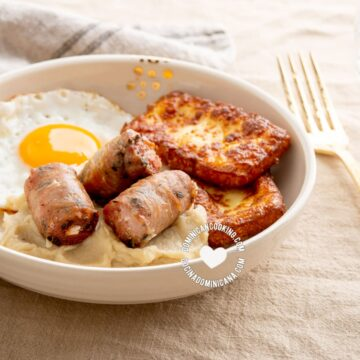 Dominican keto breakfast of fried cheese, egg and sausage with mash