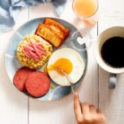 Plate of mangú with cheese, salami, and eggs