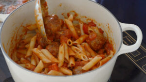 Mixing pasta and meatballs