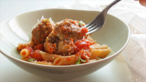 Serving pasta and meatballs