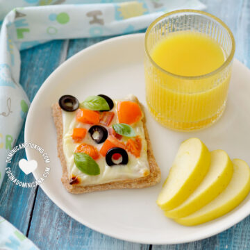 Whole Wheat Cheese and Veggies Tartlet Served with juice and an apple slices