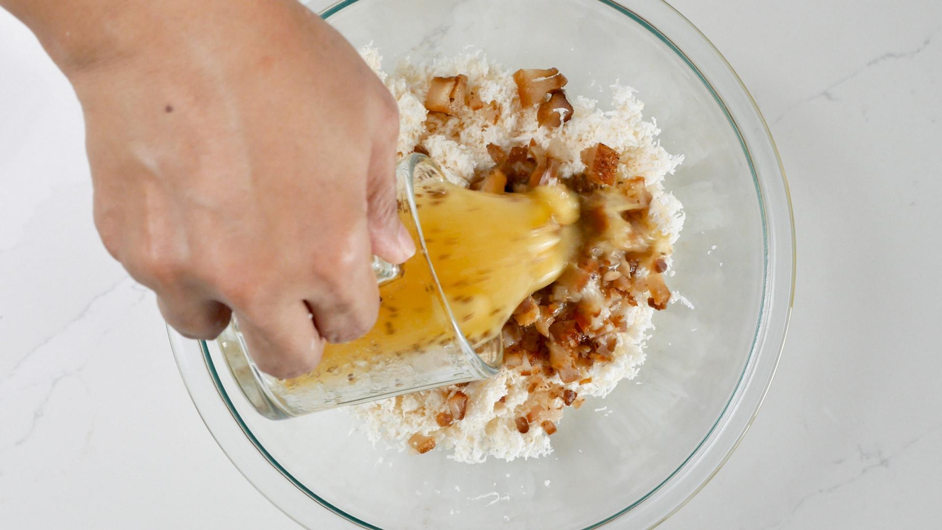 Adding broth to dough