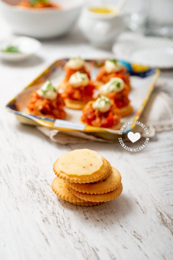 Ritz crackers topped with cheese with red pepper flakes