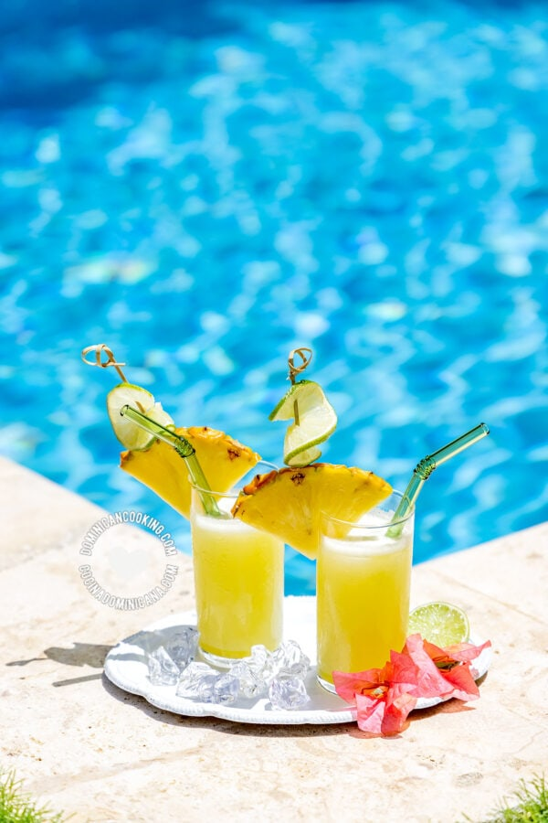 2 glasses of pineapple limeade by the pool