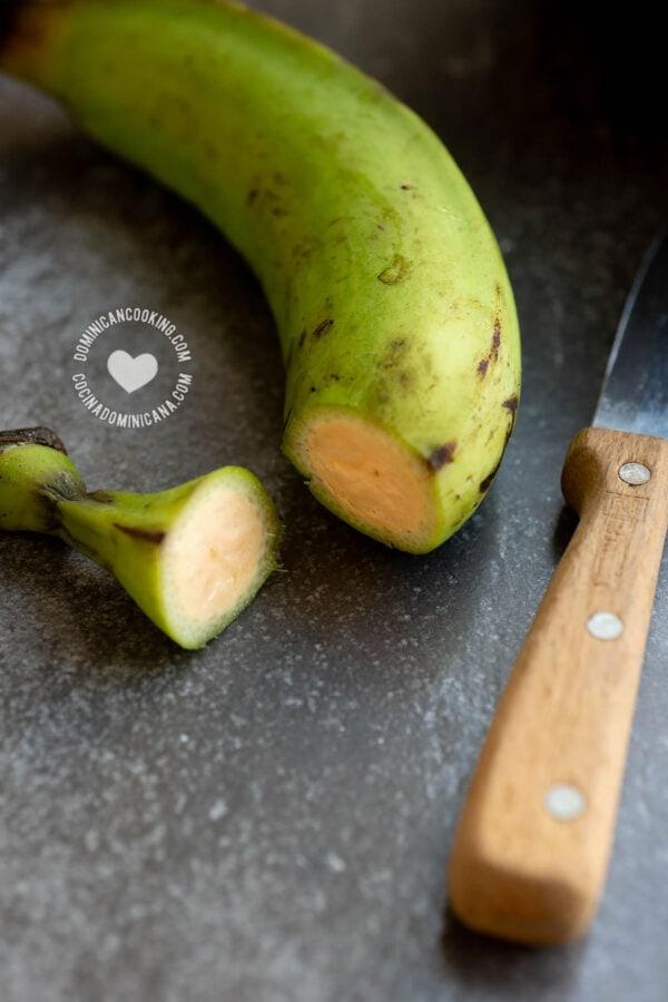 Peeling green unripe plantain