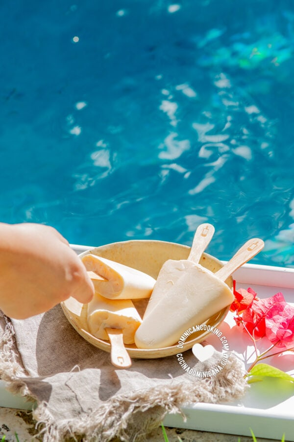 coconut popsicles by the pool