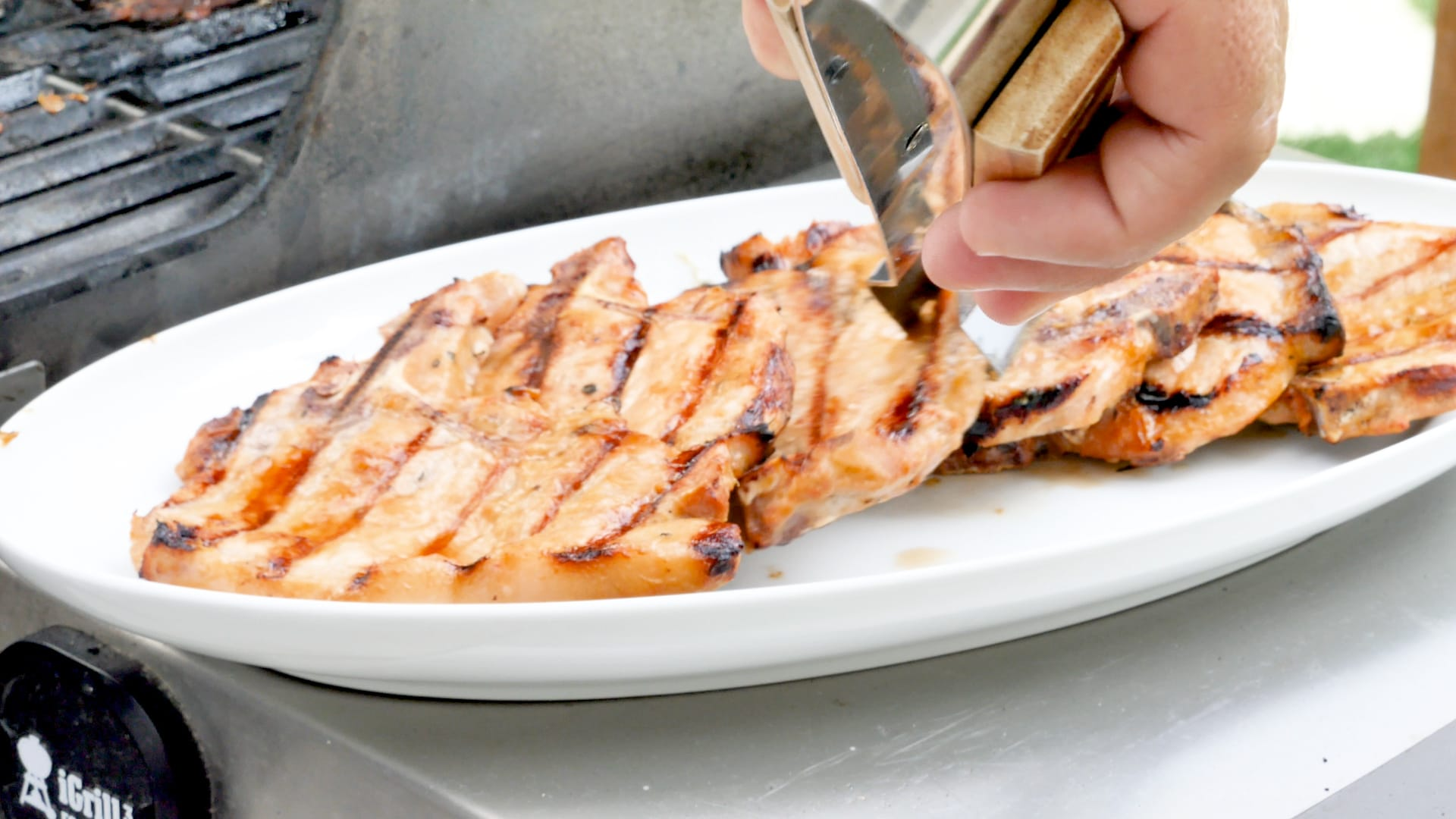 Putting the pork chops on serving plate