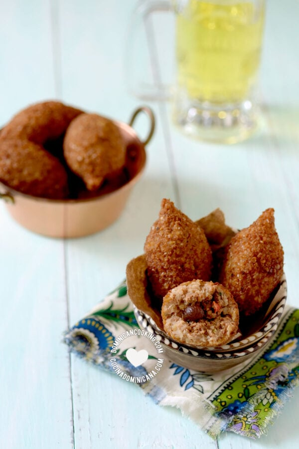 Dominican kipe (kibbeh) in two bowls, beer on the side