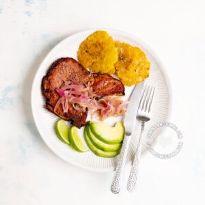 Chuletas Fritas (Dominican Fried Smoked Pork Chops) with Tostones and Avocado