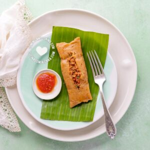 Pasteles en Hoja (Plantain and Beef Pockets with hot sauce)