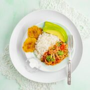 Repollo Guisado (Stewed Cabbage) served with rice and avocado