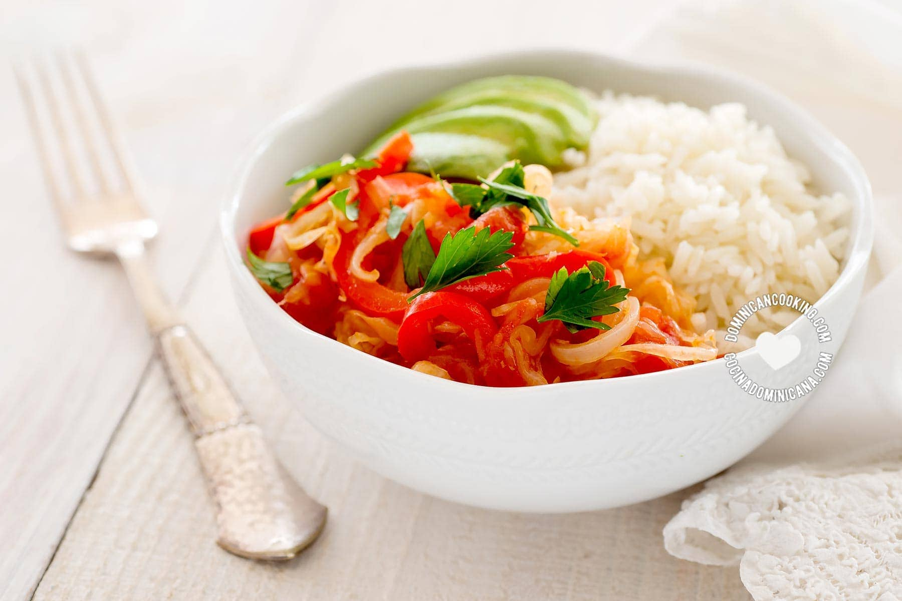 Cabbage stew served with rice and avocado