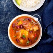 Bowl of Sancocho de Habichuelas or Sopión or Zambumbio (Sweet & Spicy Bean Stew) Served with Rice and Avocado Slices