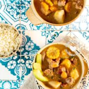 Sancocho de Siete Carnes (Seven Meat Stew) served with rice and avocado