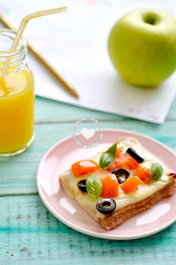 Whole Wheat Cheese and Veggies Tartlet Served with juice and an apple