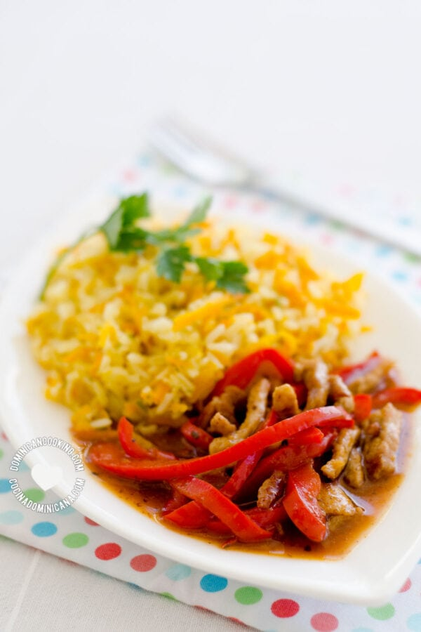 Plate of Spicy Pepper and Orange Beef with Yellow Rice