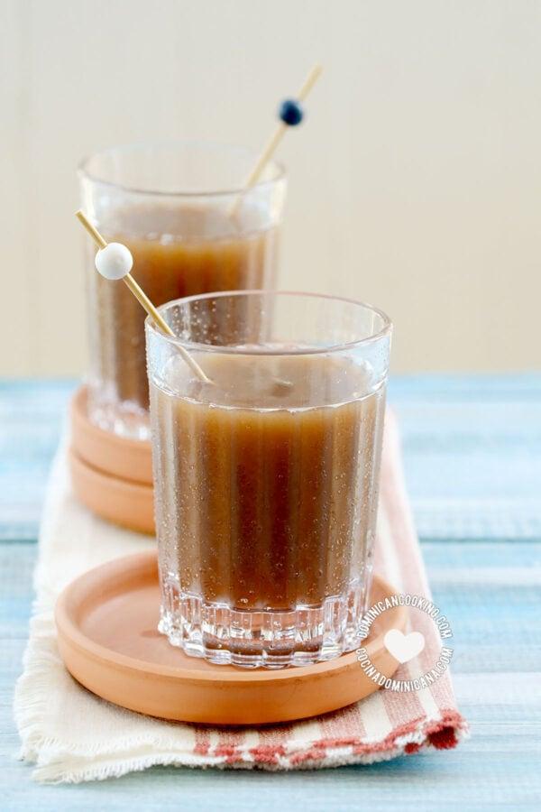 Two glasses of champola de tamarindo (tamarind juice)
