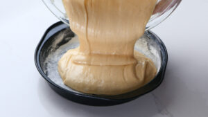Pouring batter into mold