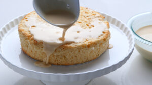 Pouring sauce over cake