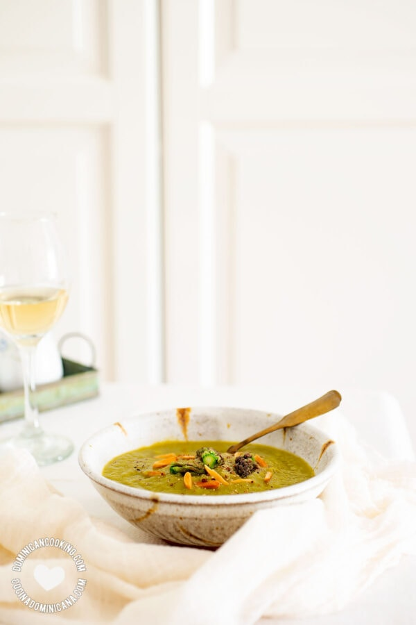 Bowl of Vegan Cream of Asparagus Soup and Glass of Wine