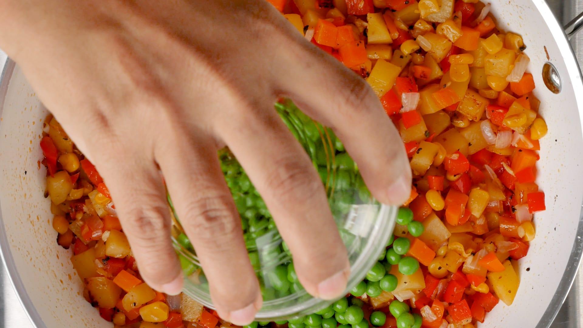 adding peas to the skillet