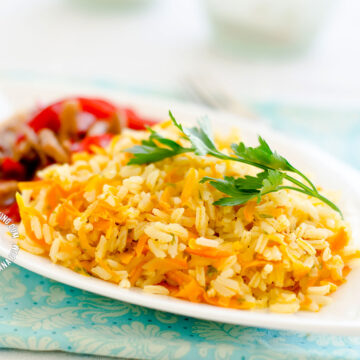 Arroz Amarillo Served with Meat (Carrot and Onions Yellow Rice)