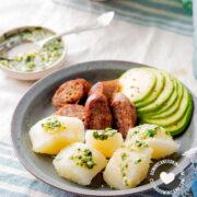 Yuca al Mojo de Ajo (Cassava with Garlic Sauce) served with avocado and longaniza