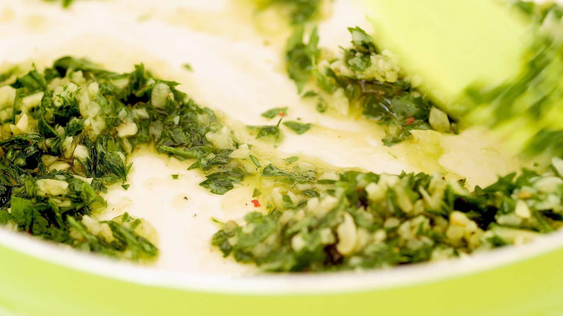Mixing ingredients for mojo de ajo