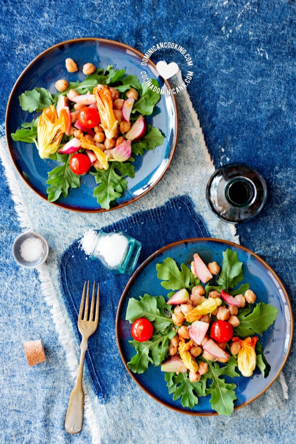 Plates of zucchini flower salad with chickpea